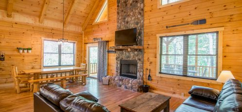 Hidden Creek Lodge - Dining Area and Living Area with View of the Fireplace