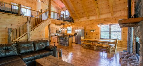 Hidden Creek Lodge - View of Dining Area with Kitchen and Loft Above from Living Room
