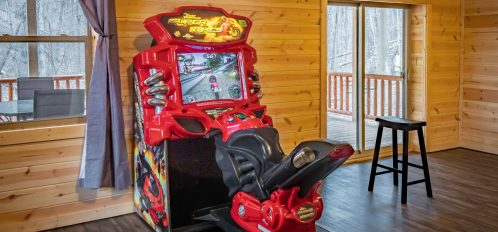 Paradise Falls Lodge - Motorcycle Arcade Game in Downstairs Den