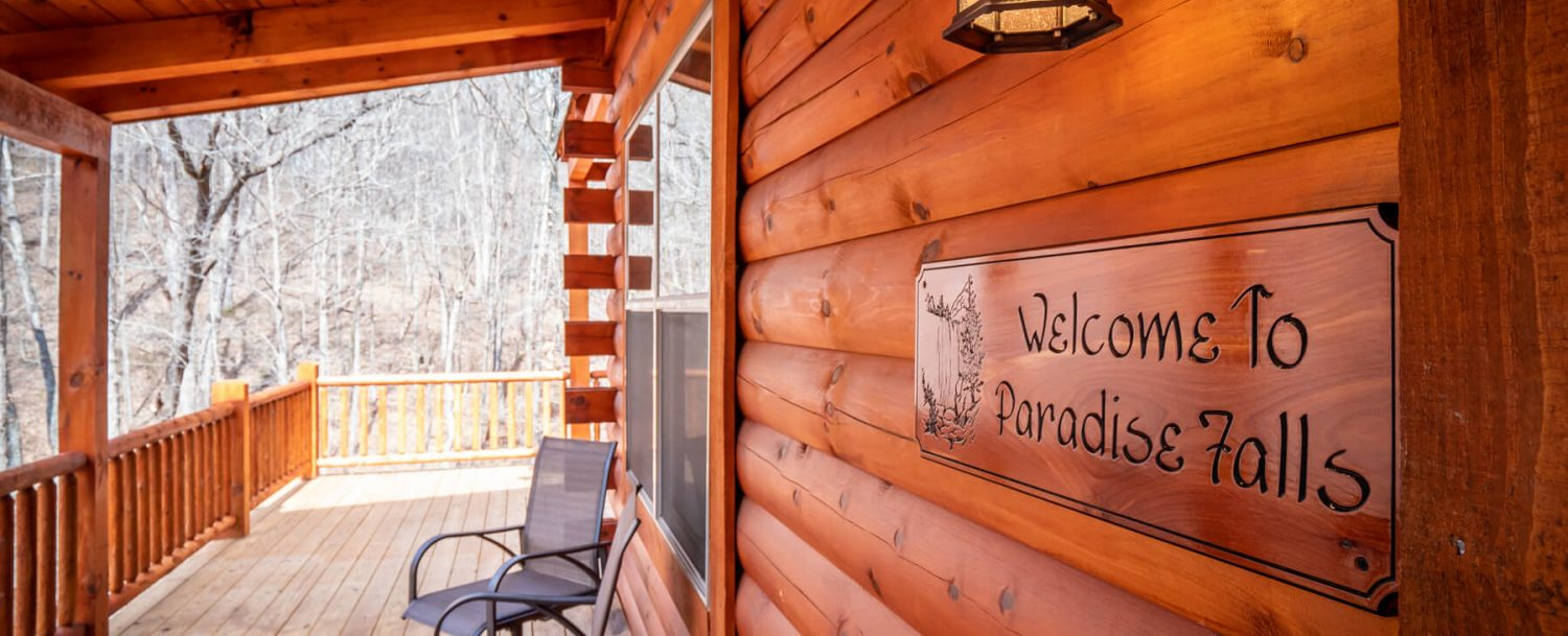 Paradise Falls Lodge - Seating Area on Porch with Welcome to Paradise Falls Sign