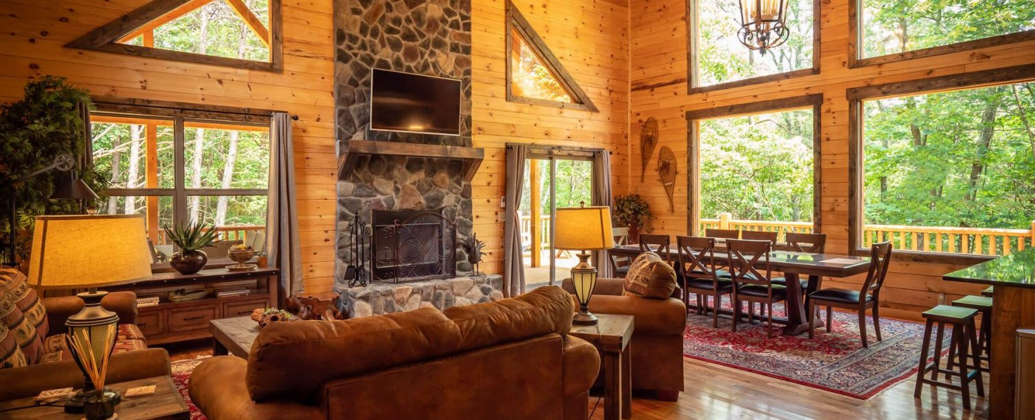 Thelma's Retreat - Living Area with Fireplace and View of Dining Area